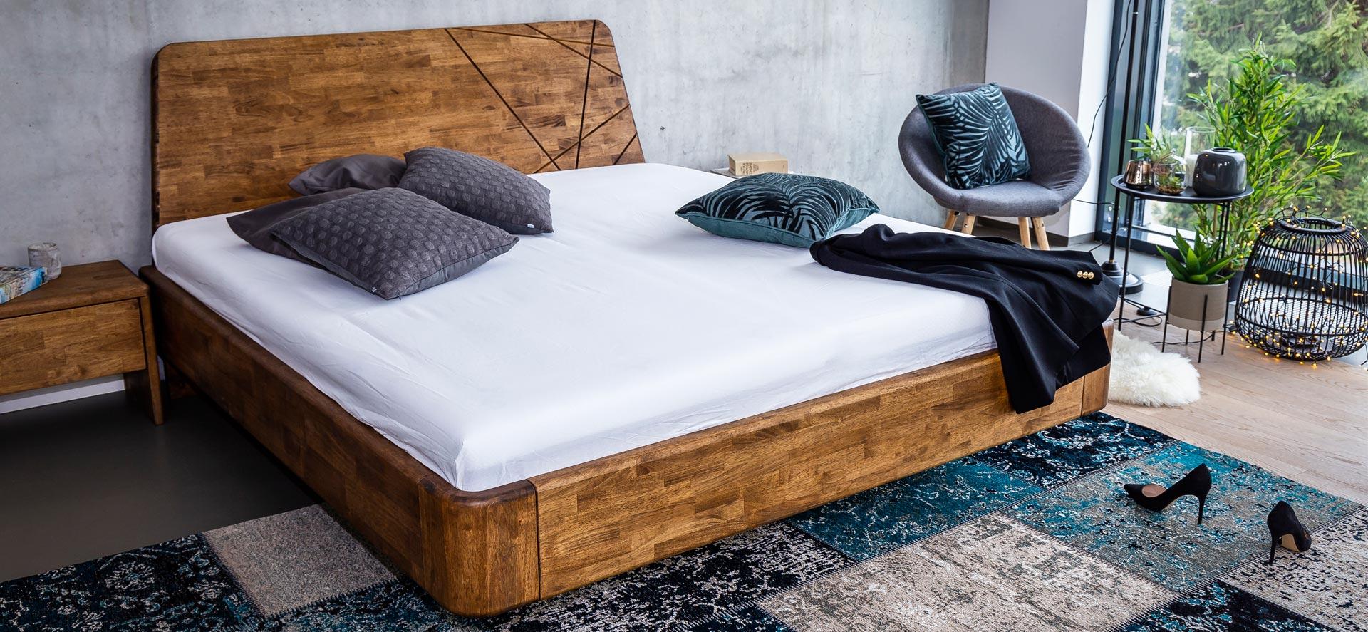 Postel z masivu NOE je vyrobena z exotické dřeviny zvané MALAJSKÝ DUB. Zaoblením všech hran a rohů jsme vám připravili model masivní postele, o kterou se nikdy nekopnete.